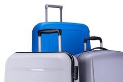 在白色背景的三个手提箱 免版税图库摄影