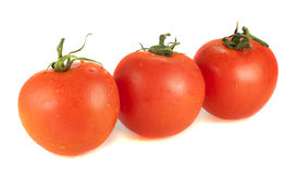 在白色背景的三个新鲜的蕃茄 库存图片