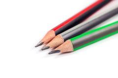 在白色背景的三支铅笔 免版税库存图片
