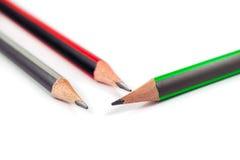 在白色背景的三支铅笔 免版税库存照片