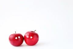 在白色背景的两个可爱的红色苹果 库存图片