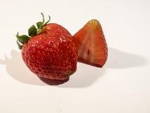 在白色背景的两个草莓 库存照片