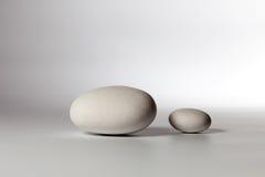 在白色背景的两块石头 免版税库存图片