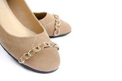 对在白色背景的棕色鞋子 免版税库存图片