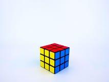 在白色背景的五颜六色的Rubik的立方体 库存照片