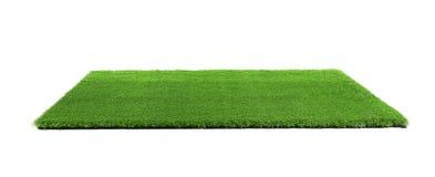 在白色背景的人为草地毯 库存图片