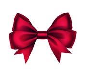 在白色背景的传染媒介发光的红色缎礼物弓 库存照片
