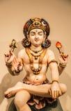 在白色背景的传统印度神雕塑 免版税库存照片