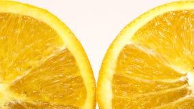 在白色背景的切的桔子 免版税库存照片