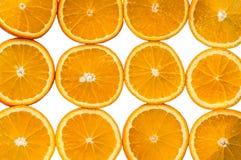 在白色背景的切的橙色桔子 库存照片
