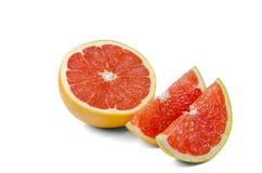 在白色背景的切的葡萄柚 库存照片