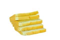 在白色背景的切的面包 免版税库存照片