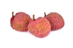 在白色背景的削皮的成熟lychee果子 库存照片