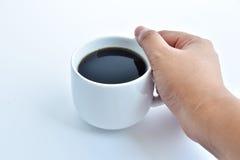 在白色背景的加奶咖啡杯子 库存照片