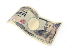 在白色背景的十tousand日元钞票 库存照片