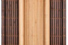 以在白色背景的原稿的形式两竹子席子扭转了 库存图片