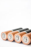 在白色背景的四个AA碱性电池 免版税库存照片