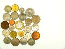 在白色背景的国际老硬币 免版税库存图片