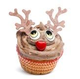在白色背景的圣诞节杯形蛋糕 库存图片