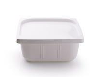 在白色背景的塑料食物箱子 库存图片