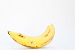 在白色背景的孤独的香蕉 库存照片