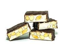 在白色背景的意大利甜点torrone 免版税图库摄影