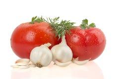 在白色背景的成熟tomatus 免版税库存照片