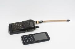 在白色背景的手提电话机被设置的老和电话 库存图片