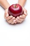 在白色背景的把柄红色苹果 免版税库存图片