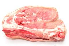 在白色背景的新鲜的猪肉 免版税图库摄影