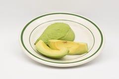 在白色背景的新鲜的绿色鲕梨 图库摄影