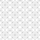 在白色背景的无缝的乱画心脏样式 免版税图库摄影