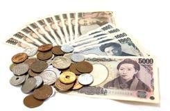 在白色背景的日本金钱 免版税库存照片