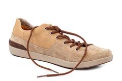 在白色背景的时兴的运动鞋鞋子鹿皮鞋 免版税图库摄影
