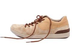 在白色背景的时兴的运动鞋鞋子鹿皮鞋 库存图片