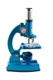 在白色背景的显微镜 免版税库存照片