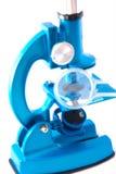 在白色背景的显微镜 图库摄影
