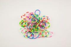 在白色背景的有弹性彩虹织布机带 免版税库存图片