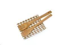 在白色的木炊事用具 免版税库存照片