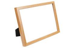 在白色背景的木空的照片框架 图库摄影