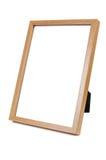 在白色背景的木空的照片框架 免版税库存照片