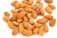 在白色背景的杏仁superfood 健康生活的概念 关闭 坚果填装整个框架 免版税库存照片