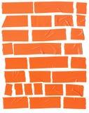 在白色背景的橙色塑料透明胶带 免版税库存照片