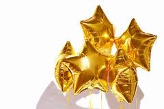 在白色背景的欢乐金黄星球 免版税库存图片