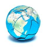 在白色背景的残破的行星地球 免版税图库摄影