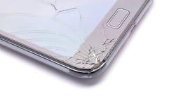 在白色背景的残破的玻璃电话 免版税库存照片