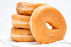 在白色背景的油炸圈饼 免版税库存照片