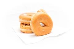 在白色背景的油炸圈饼 库存照片