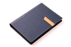 在白色背景的深蓝色的组织者书 免版税库存图片