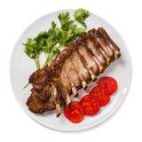 在白色背景的烤猪肉排骨 图库摄影